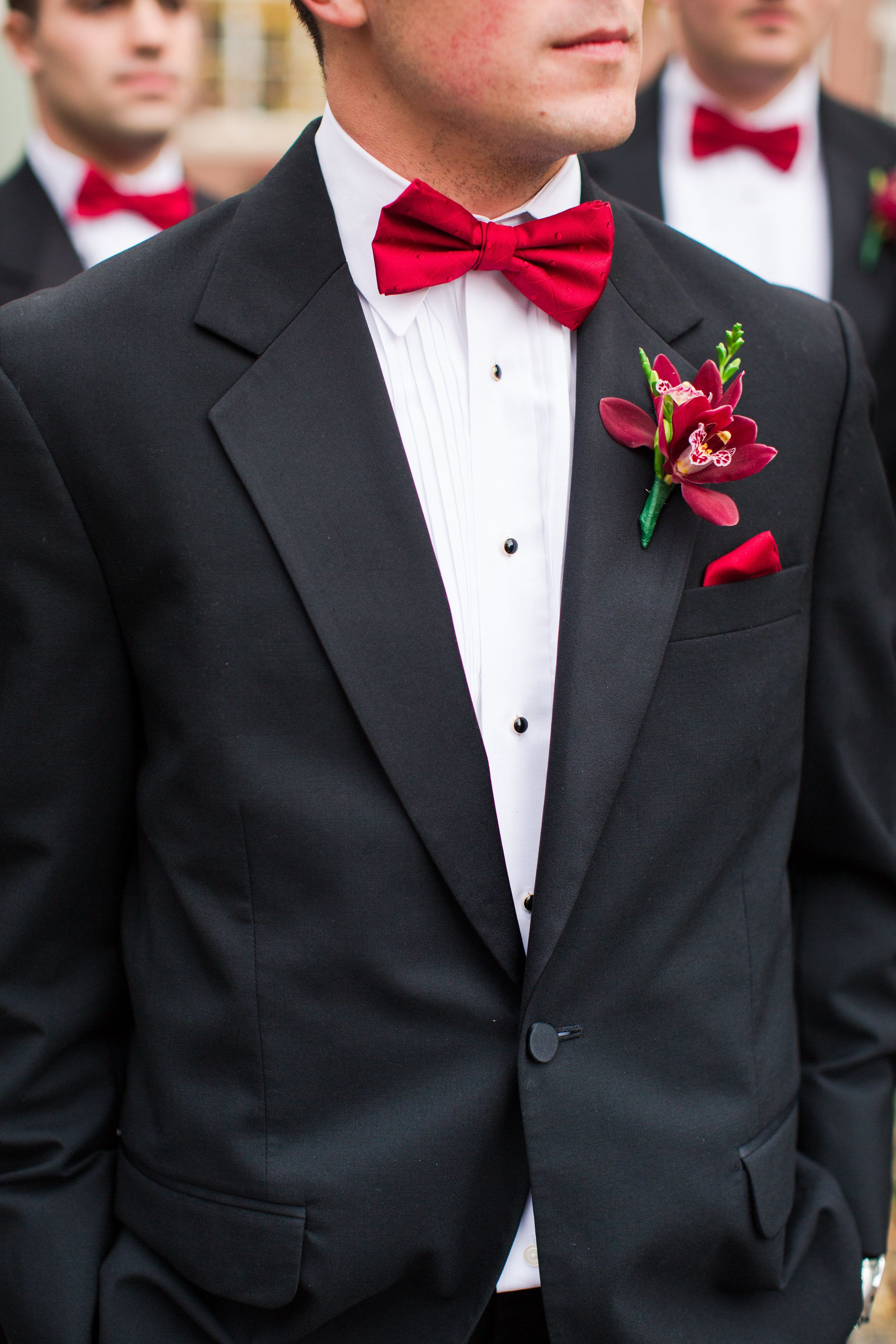 all black tux with red bow tie photo - 1