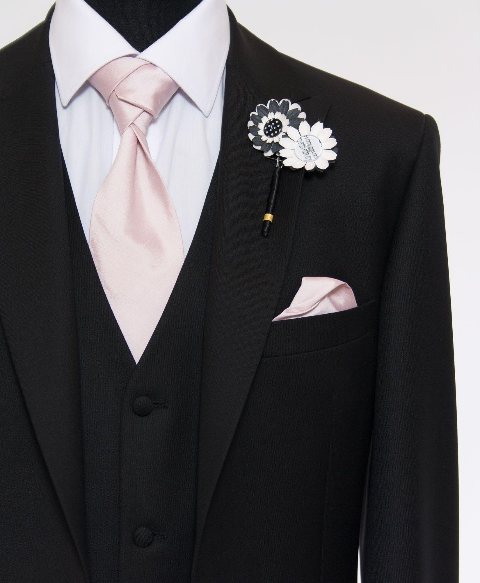 black suit pink tie photo - 1