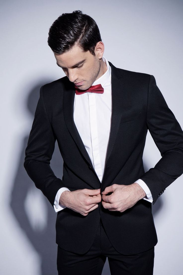 black suit red bow tie photo - 1