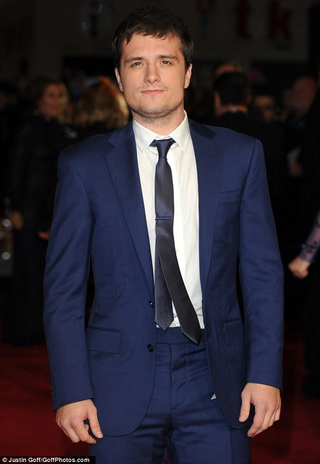 blue suit brown tie photo - 1