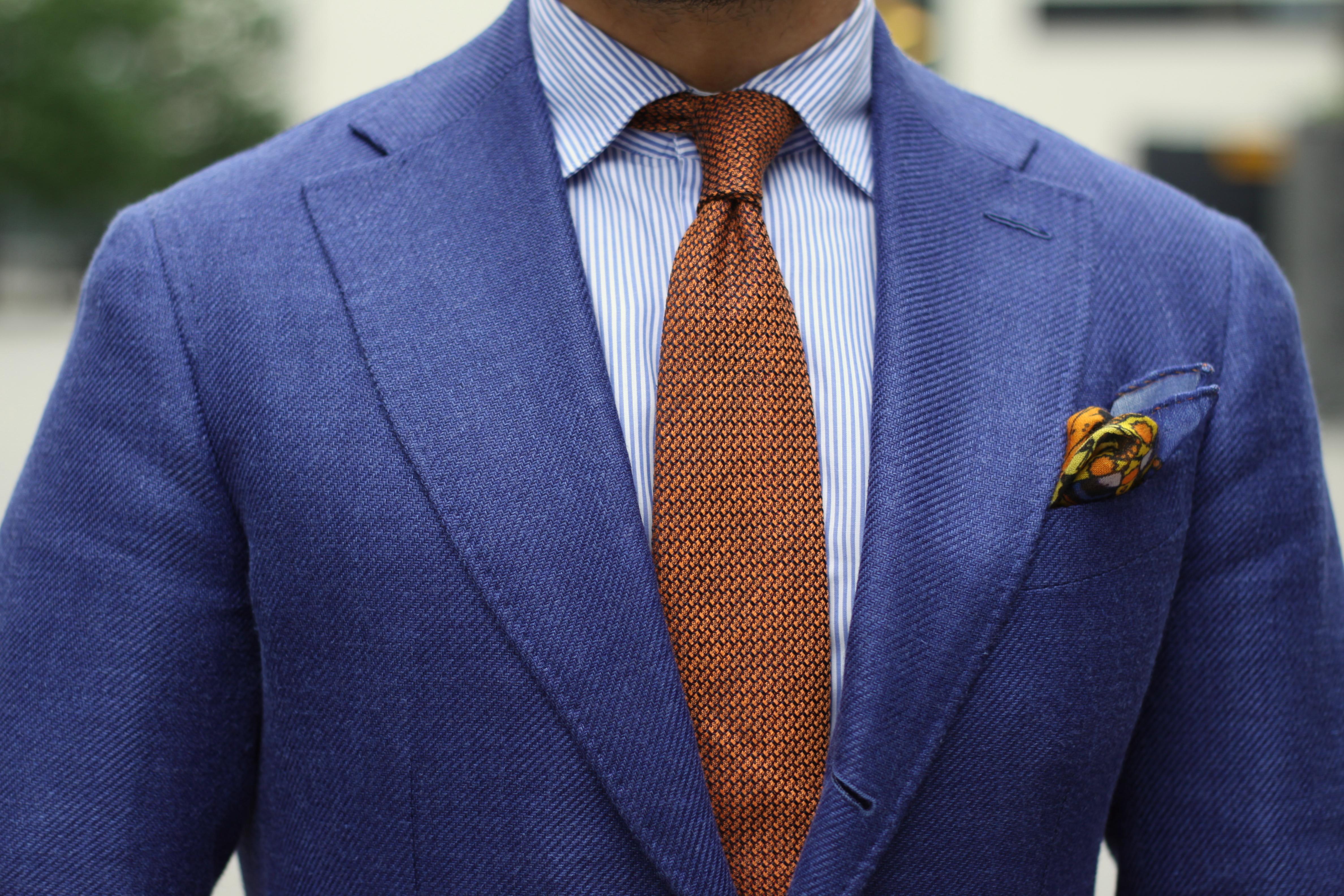 blue suit orange tie photo - 1
