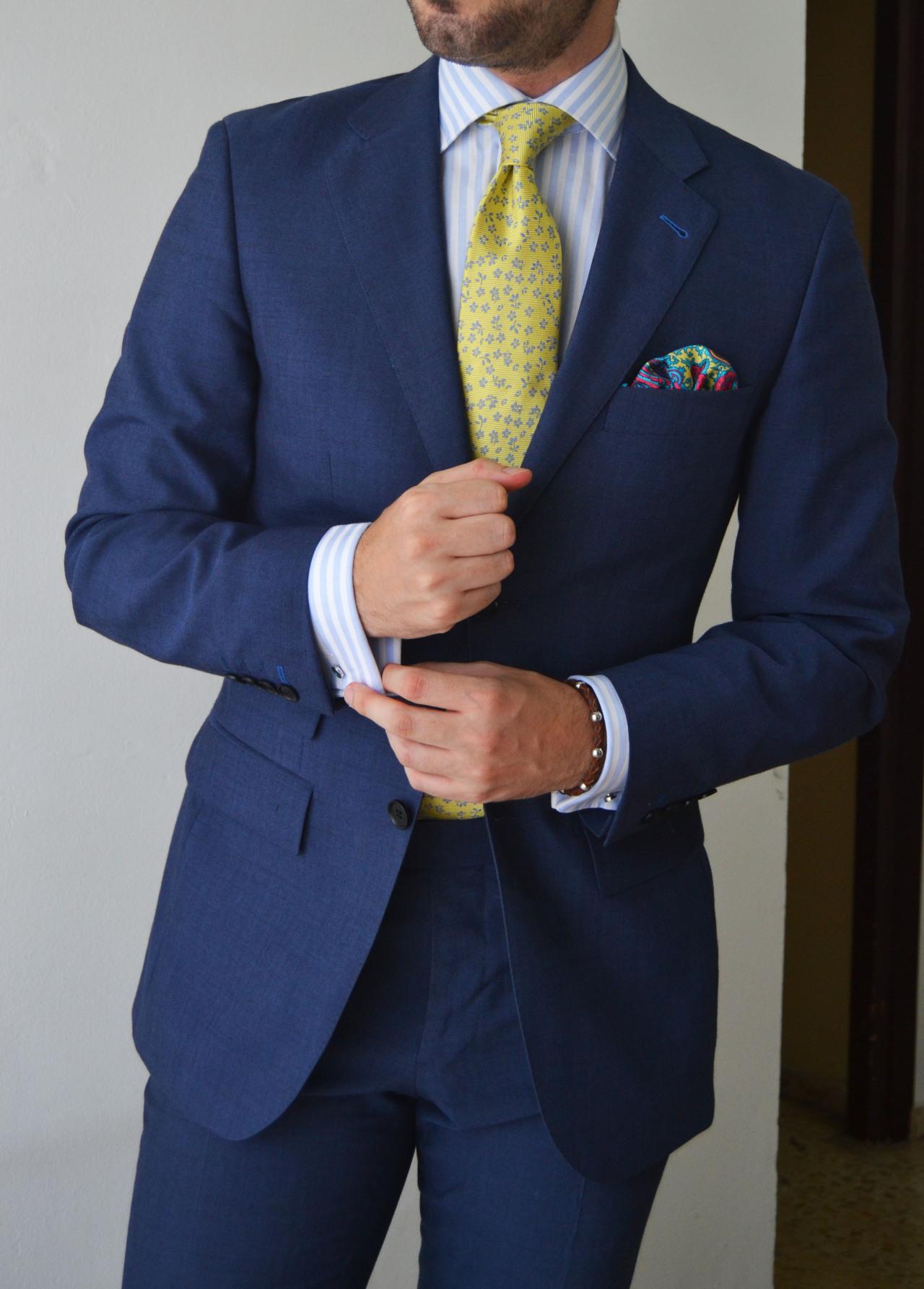 blue suit yellow tie photo - 1