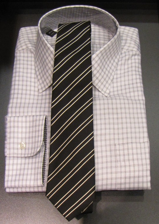 checkered shirt with striped tie photo - 1
