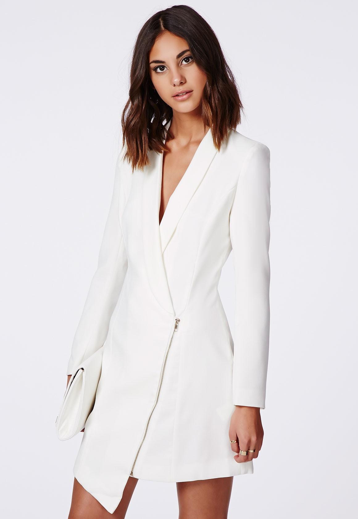 women white suit jacket photo - 1