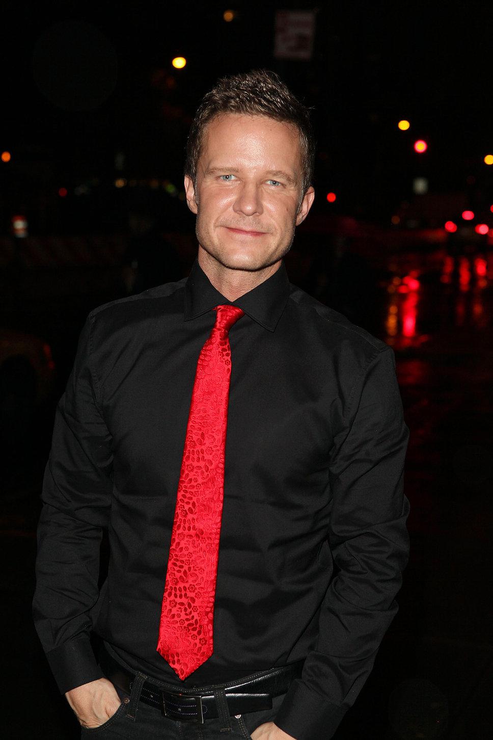 black shirt red tie photo - 1