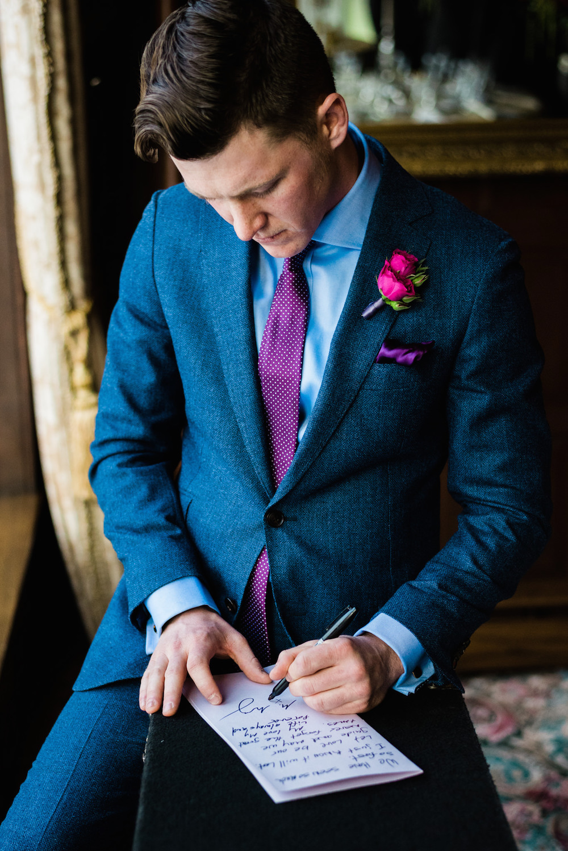blue suit purple tie photo - 1