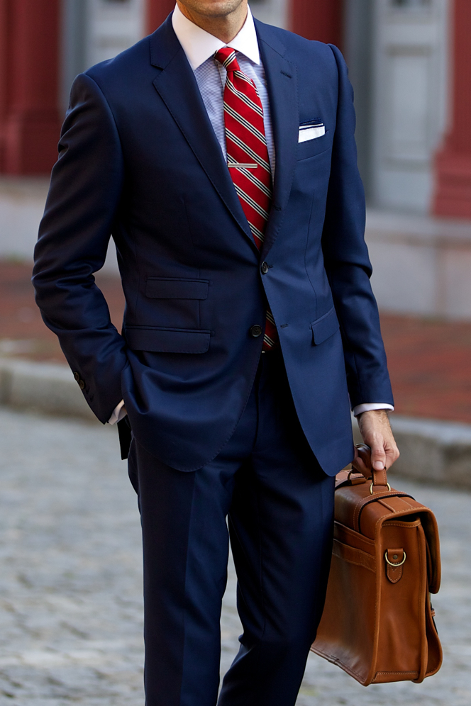 blue suit red tie photo - 1